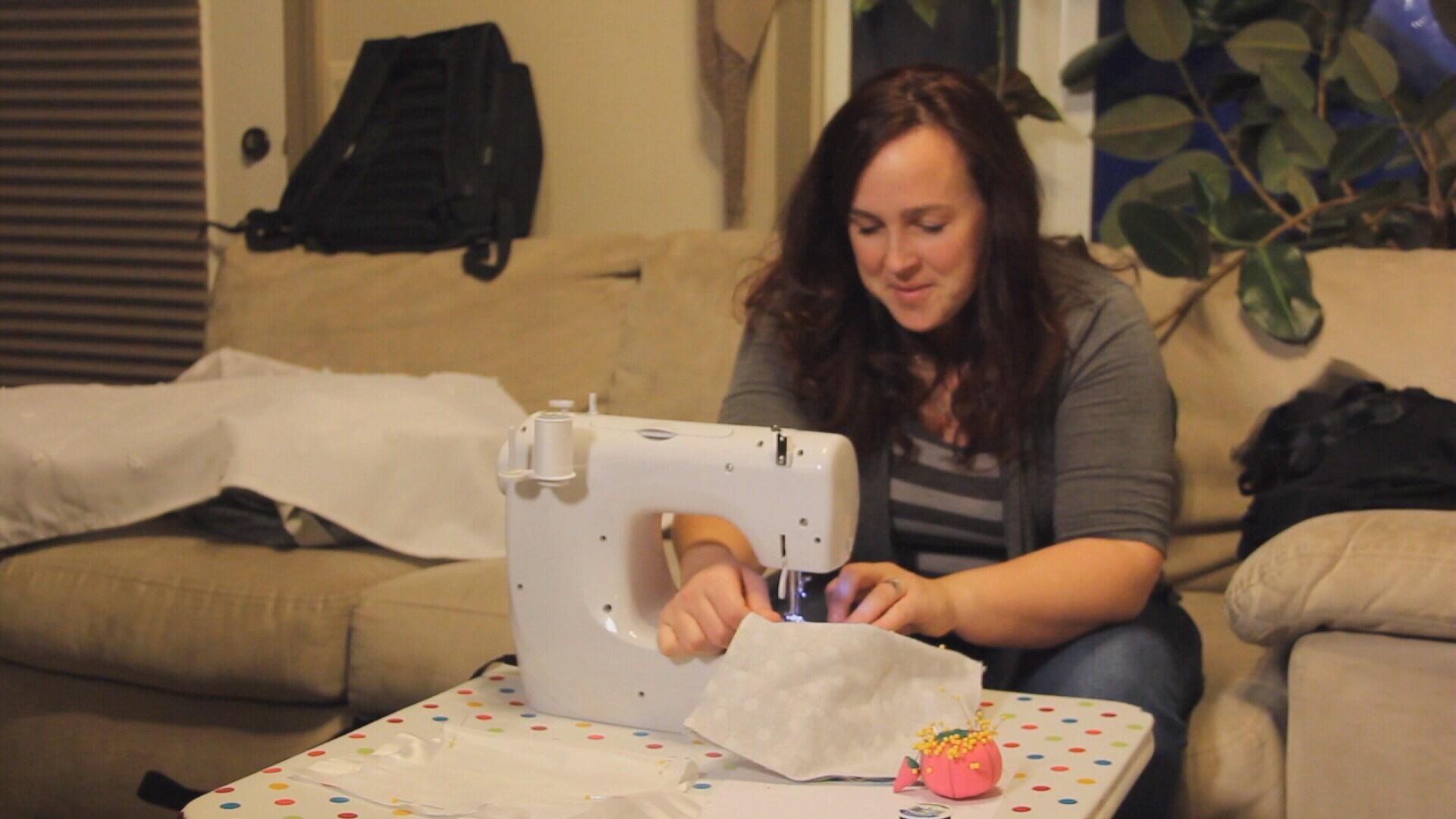 Mindy Bausch sews a wrap for a stillborn (MTN News)