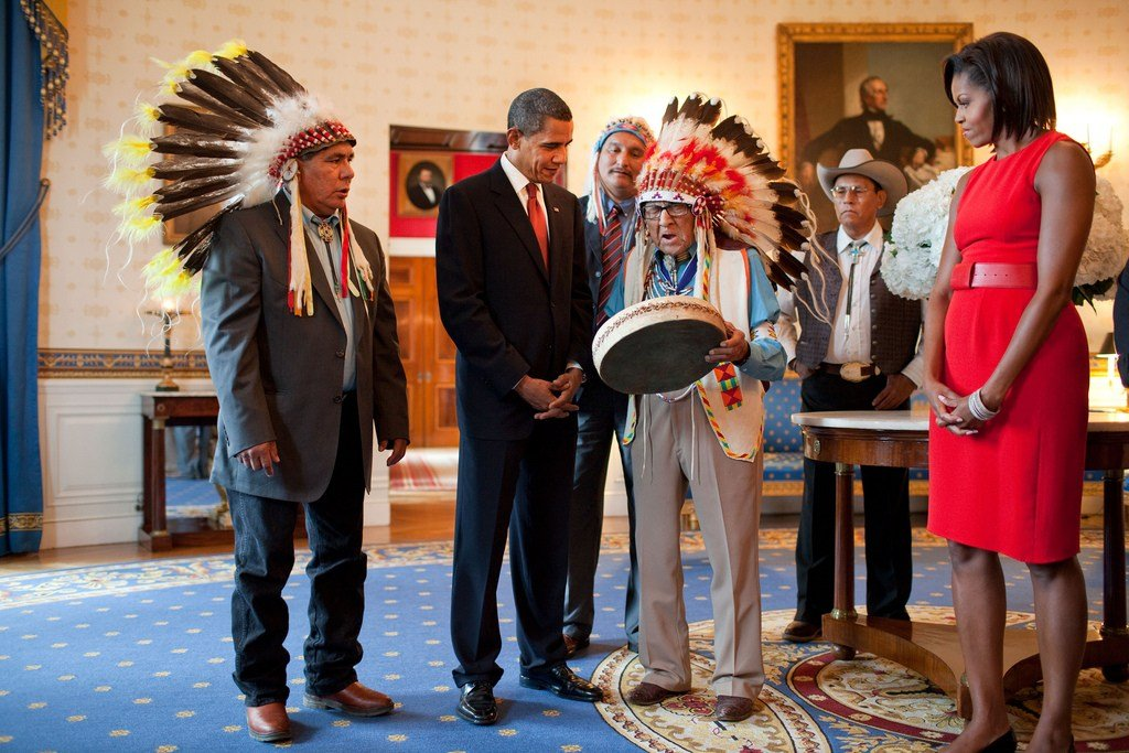 Joseph Medicine Crow shows a drum to President Barack Obama and First Lady Michelle Obama at the White House in August 2009. (Official White House photo by Pete Souza)