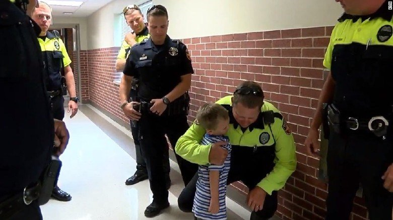 Amarillo police officers hug Jackson Scherlen on his first day of pre-K.