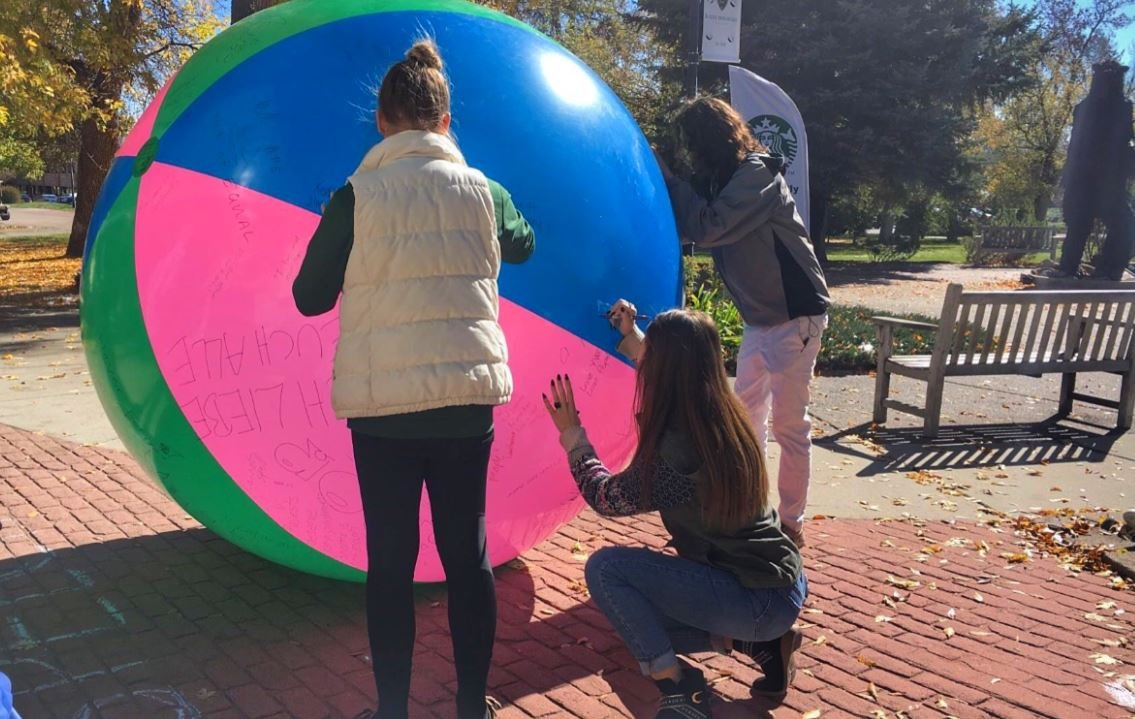 A recent event at Rocky Mountain College encouraged students to exercise their free speech rights by writing on a large beach ball. (MTN photo/Molly Davis.)