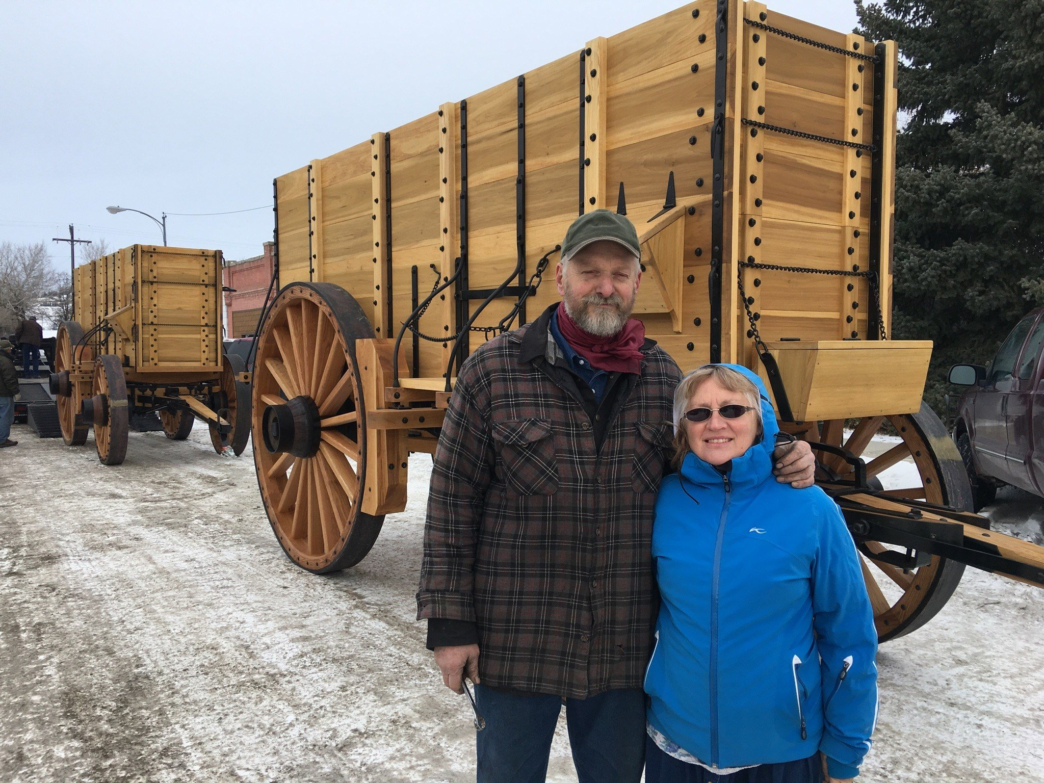 Dave and Diane stood in front of the creations before the wagons were shipped to California on Tuesday. (MTN News Photo)