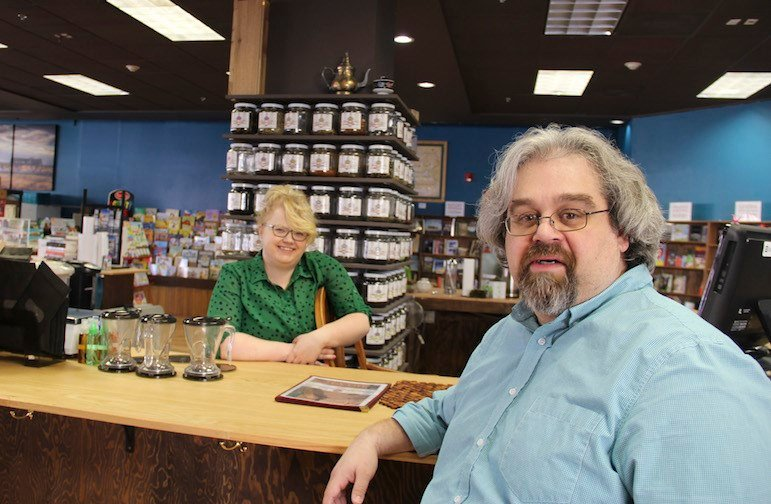 Gustavo Belotta is the new manager of This House of Books in downtown Billings. Jamie Winter, behind the counter, is the new manager of the store's tea bar. (Credit: Ed Kemmick/Last Best News)