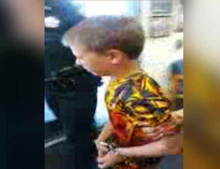 A still image from a video shot by the mother of John Benjamin Haygood, 10, when he was arrested at school. LUANNE HAYGOOD