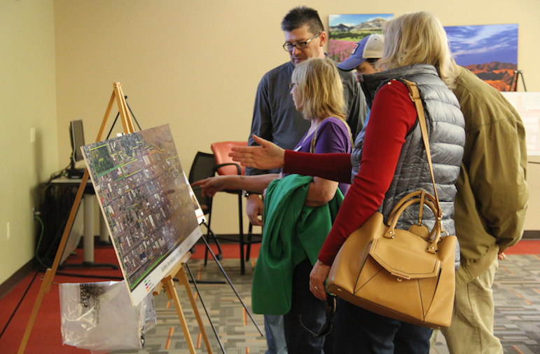 After the annual meeting of the Billings Industrial Revitalization District on Wednesday, attendees checked out maps of the district and information on upcoming projects. (Credit: Ed Kemmick/Last Best News)