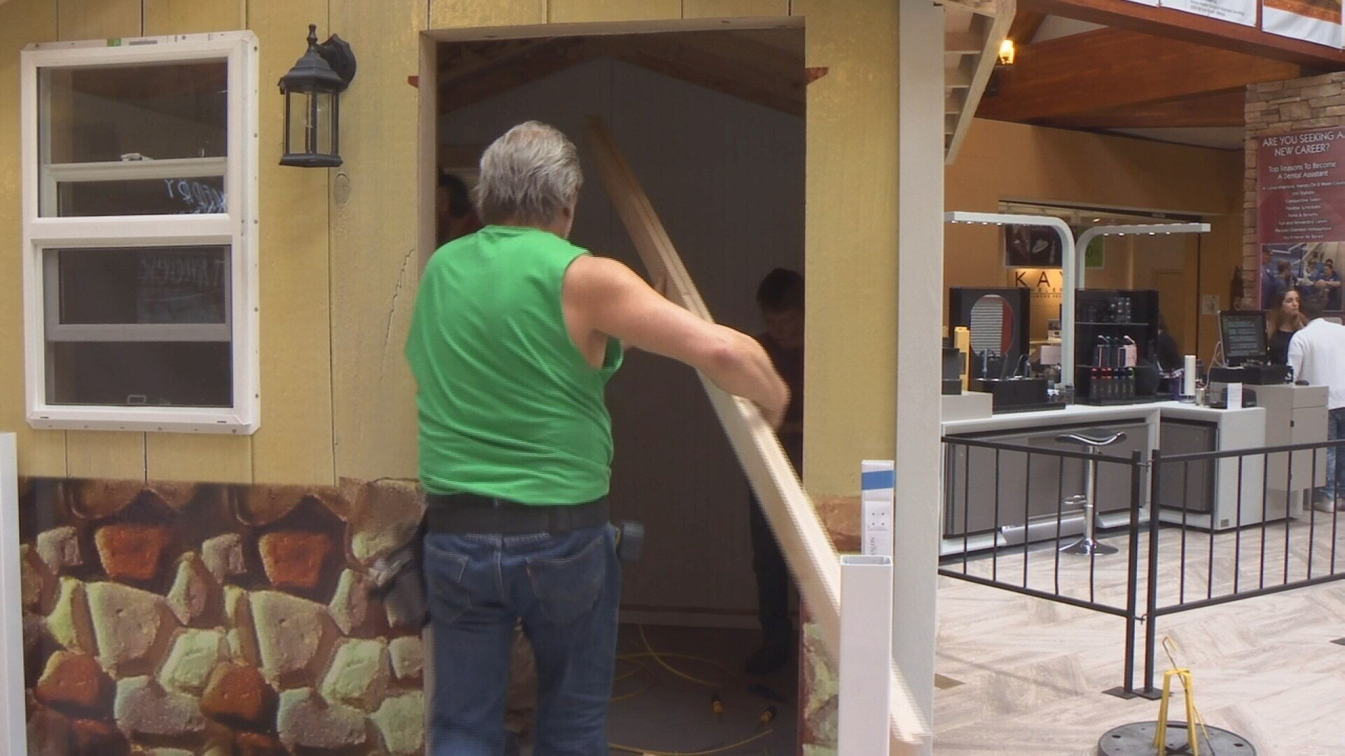 Contractors work on playhouse at Rimrock Mall