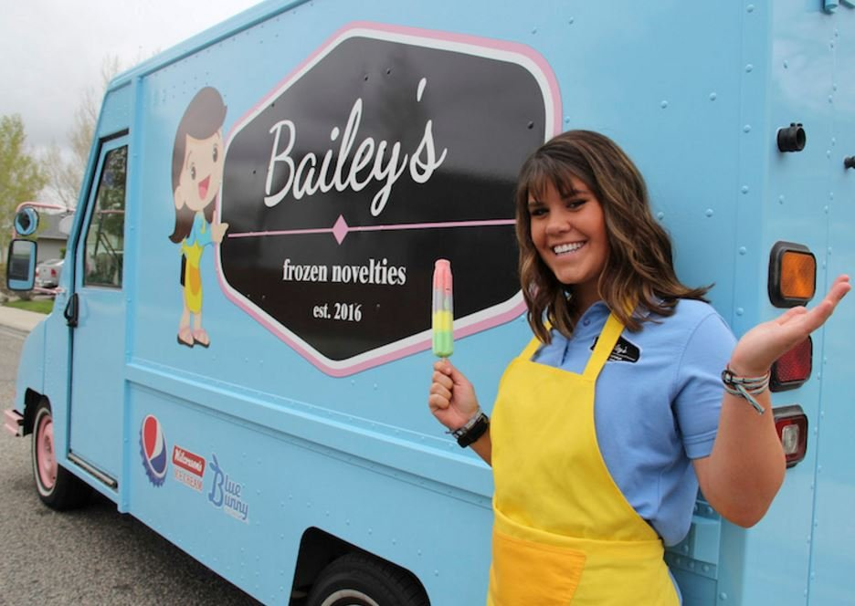 It took a lot of work to convert a heating and cooling van into world headquarters of Bailey's Frozen Novelties, but Bailey Scott couldn't be prouder of her vehicle. (Ed Kemmick/Last Best News)