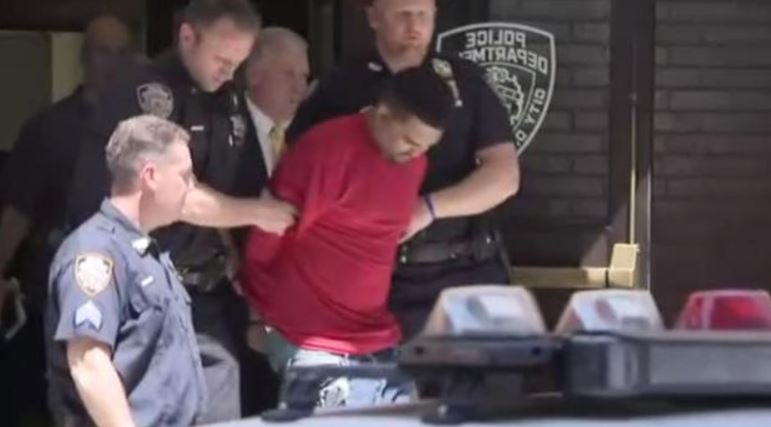 Richard Rojas of New York escorted out of a NYPD precint on Thu., May 18, 2017. He's accused of plowing through pedestrians in a crowded Times Square, killing one person. CBS NEW YORK