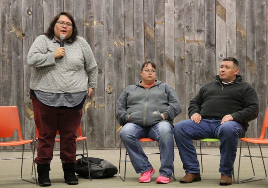 During a public forum in Billings, Meg Singer, left, with the Montana ACLU, introduced Brandy and Elsworth GoesAhead. (Ed Kemmick/Last Best News)