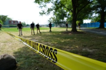 The FBI combs the perimeter at Eugene Simpson Stadium Park Thursday morning a day after a shooting during a congressional baseball practice. (Credit: Chris Welch/CNN)