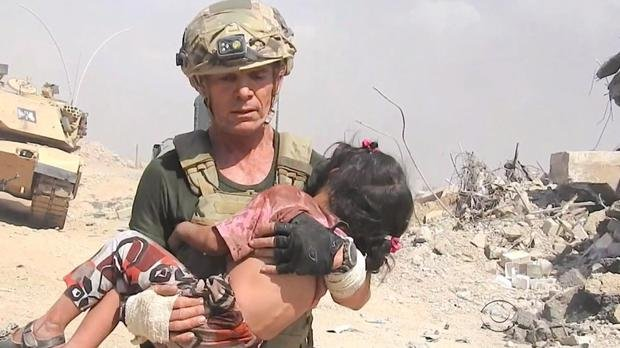 David Eubank darted past ISIS snipers to save a young girl in Mosul. (CBS News)