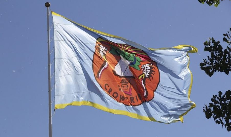 The tribal flag flies over Crow Agency on Wednesday, the first day of summer. (Ed Kemmick/Last Best News)