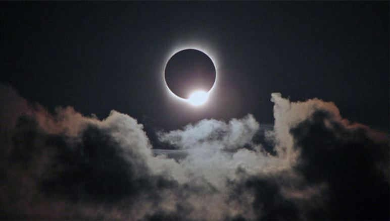 Just before and after totality, the eclipsed sun takes on the appearance of a diamond ring as shafts of sunlight blaze through canyon's on the moon's rugged limb. (RICK FIENBERG/TRAVELQUEST INTERNATIONAL/WILDERNESS TRAVEL)