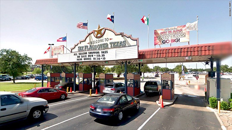Six Flags Over Texas is no longer flying the Confederate flag pictured here, to the left of the American flag. This picture was taken prior to Aug. 18, when Six Flags took it down.
