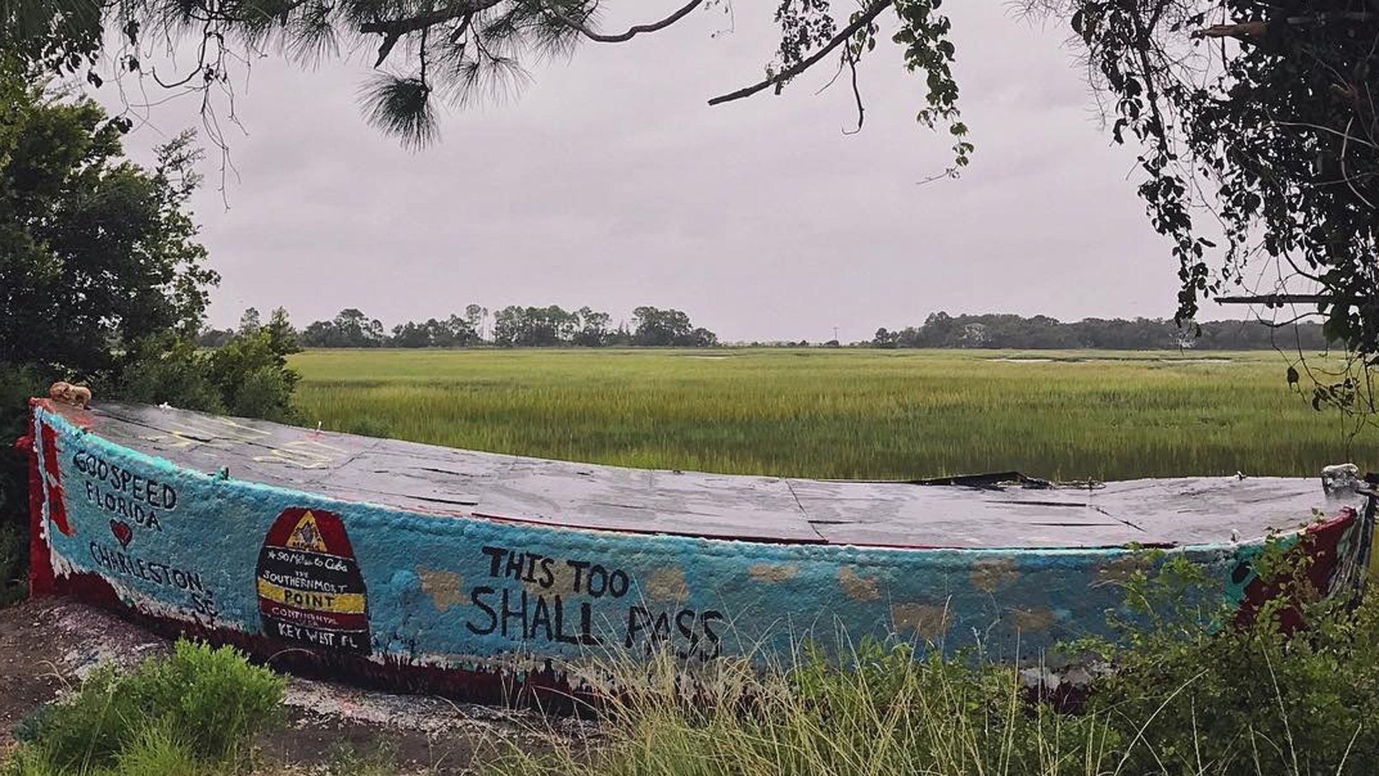 Stephanie Lee took this photo of the famous Folly Boat that was a landmark on the road to Folly Beach. The boat is often painted with messages and pictures. Lee took this photo on Sunday night. (CNN)