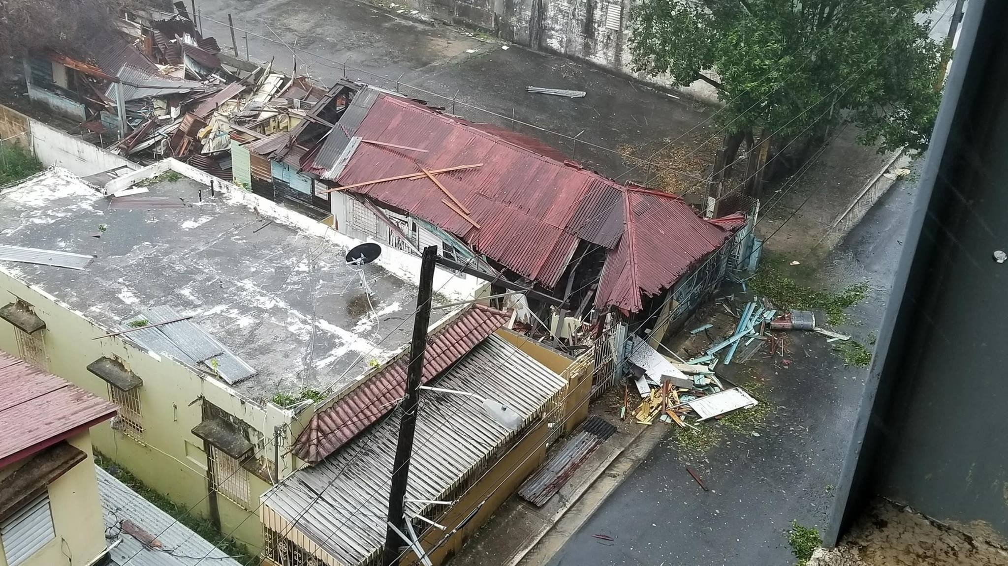 Roofs ripped off houses in San Juan, Puerto Rico as Hurricane Maria slammed into the city on September 20, 2017. photo courtesy of CNN.