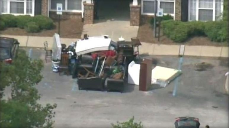 Authorities piled furniture outside the apartment building where a deputy serving an eviction notice on Monday, Sept. 19, 2017, found the body of a baby in a sealed container.  CBS AFFILIATE WSPA