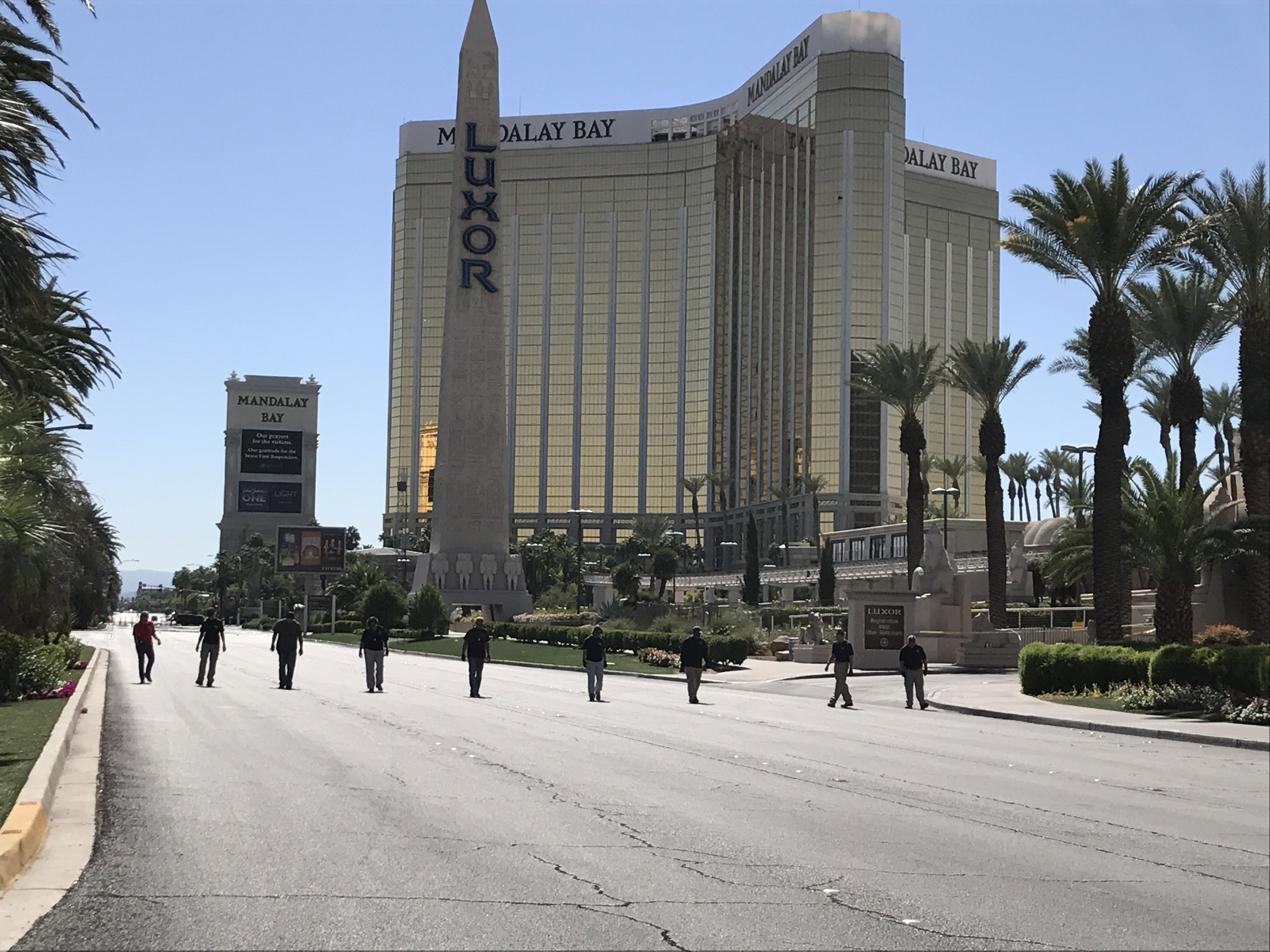 Las Vegas Blvd. closed off with crime scene tape two days after the mass shooting by Stephen Paddock. FBI investigators walk the street in front of Mandalay Bay and Luxor looking for clues. courtesy of CNN.
