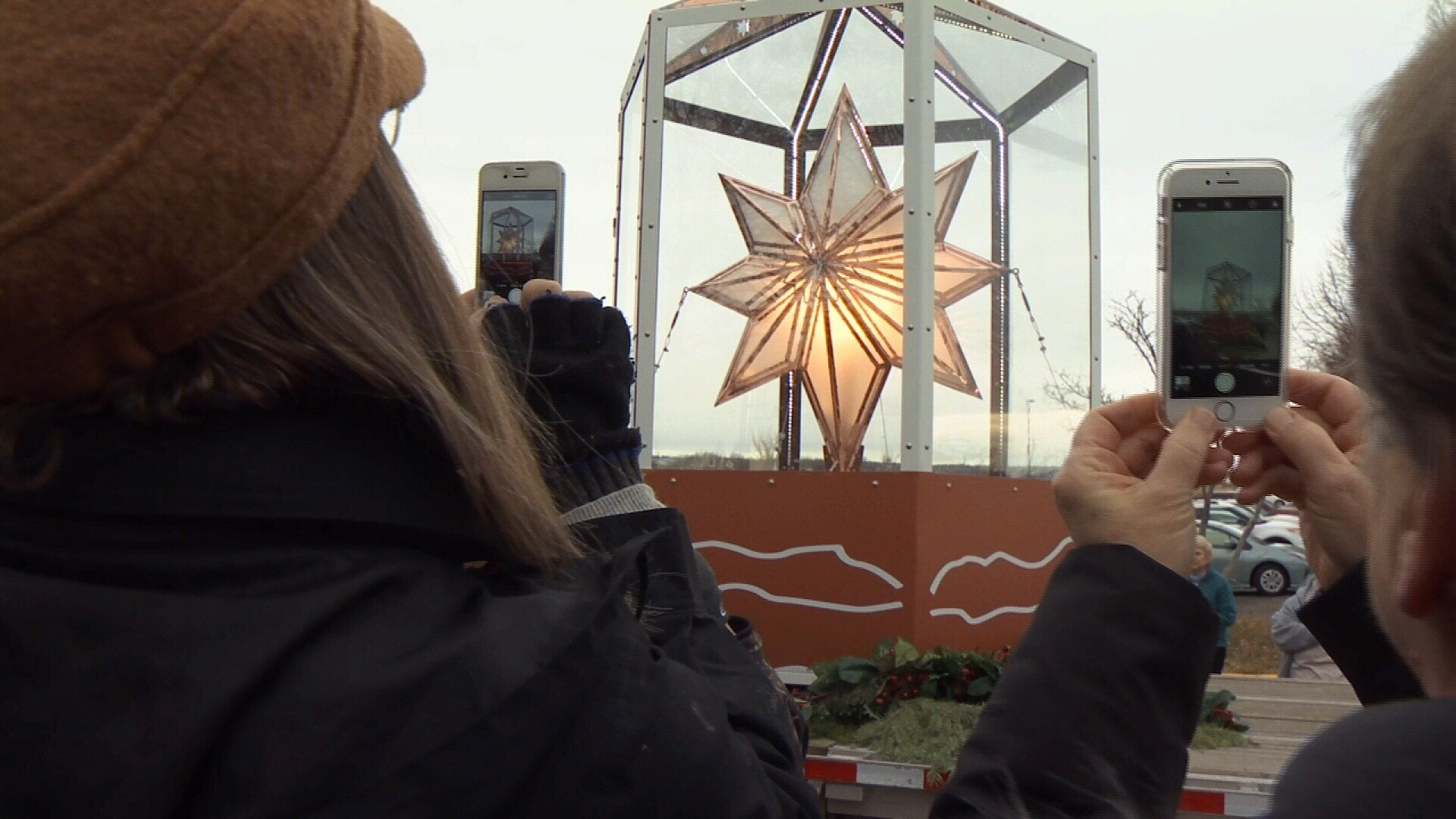 Two women take a photo of the copper star when it made a stop in Billings on Wednesday morning