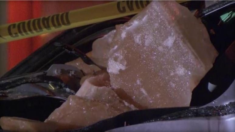A look at an ice chunk that destroyed an SUV in Manhattan on Tue., Jan. 9, 2018. / CBS NEW YORK