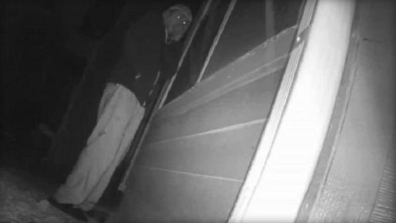 Terrifying moment 'moaning' man is caught staring through bedroom window