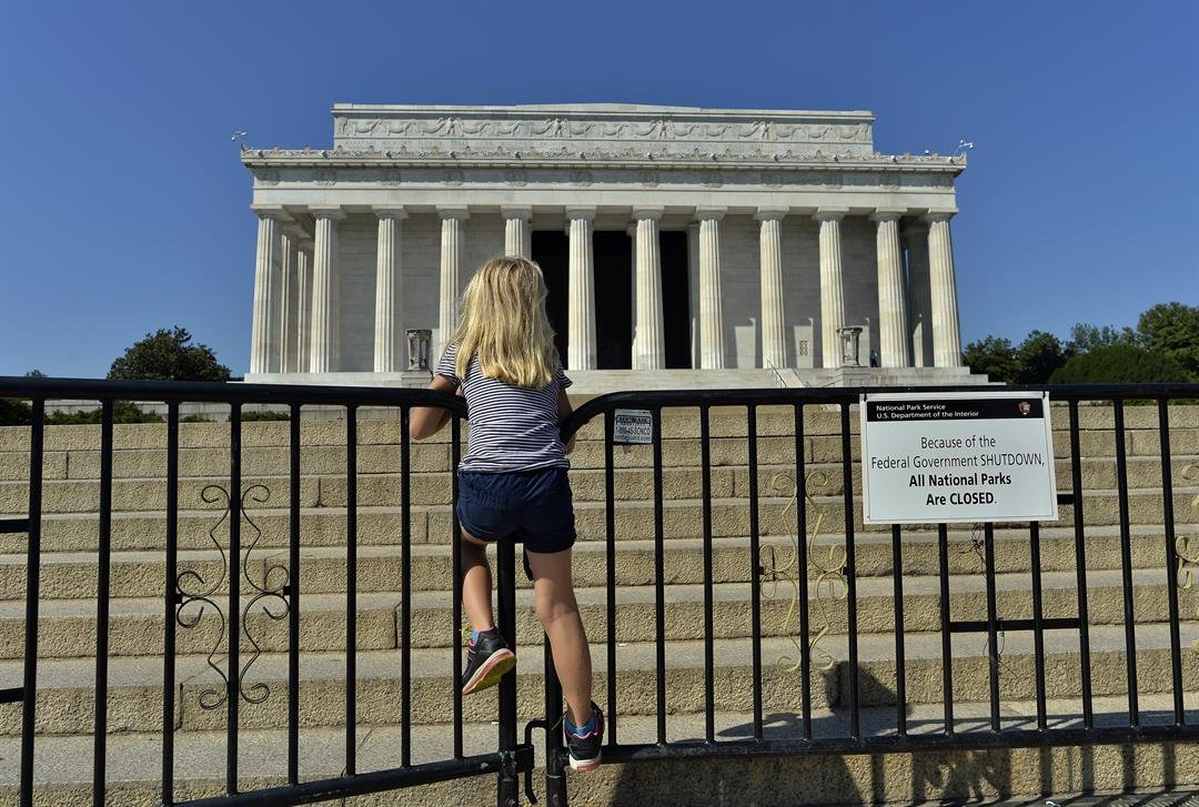 A child stands on the barricade around the Lincoln Memorial in Washington, DC, on October 2, 2013, on the second day of the federal government shutdown. courtesy of CNN.