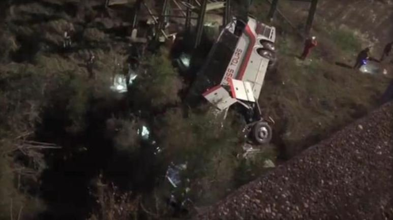A charter bus carrying students home to Texas from a high school band trip to Disney World plunged into an Alabama ravine early Tuesday, and numerous children were being carried by helicopters to emergency rooms. FACEBOOK / JESUS TEJEDA