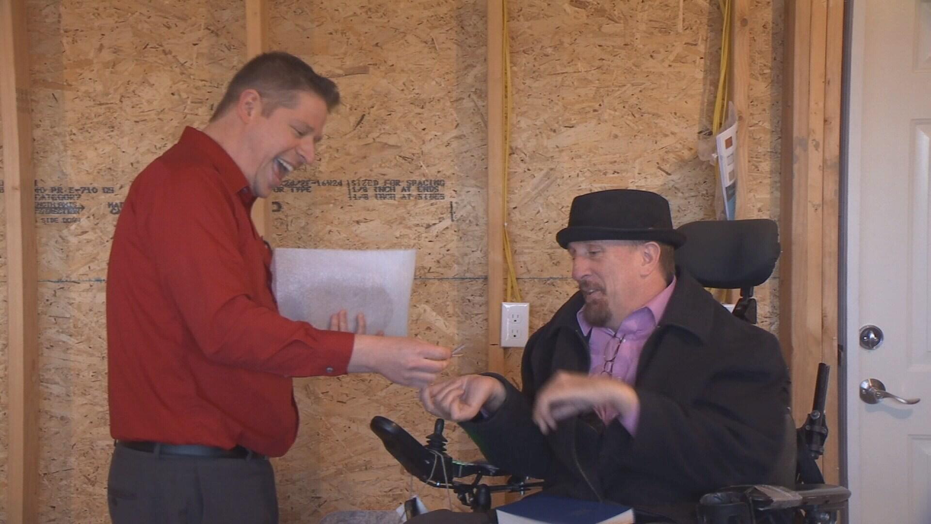 Jim Woolyhand gives keys to Jim Brown.