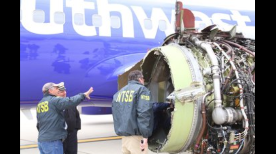 The National Transportation Safety Board is seen here onsite inspecting the Southwest airline plane after engine failure caused the plane to make an emergency landing at Philadelphia International Airport.