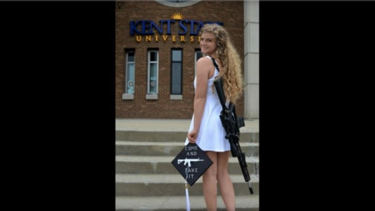 A Kent State graduate wore a gun holster around her body and a picture of a gun on her graduation cap in viral photos / KAITLIN BENNETT