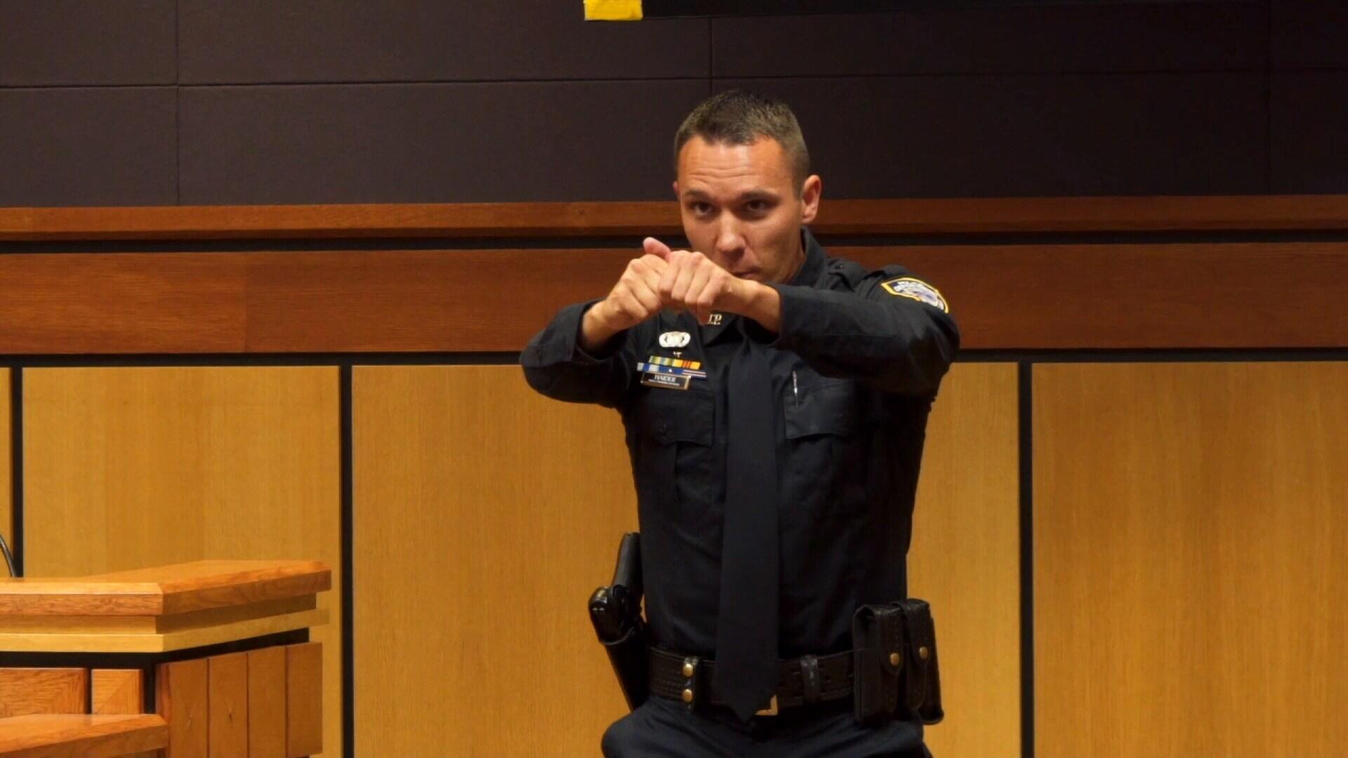 Officer Haider demonstrates during his tesimony (MTN News/Brandon Sullivan Photo)