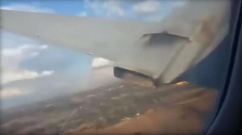 A view out the window of a crashing plane is shown in this screen grab from a video shot on a phone inside the cabin.  AIRLIVE