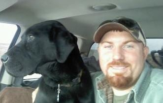 Cassie Dennison's black Lab, Mac, seen here with her husband Travis, was put down by the county before Dennison even knew Mac had been impounded. Ed Kemmick/Last Best News