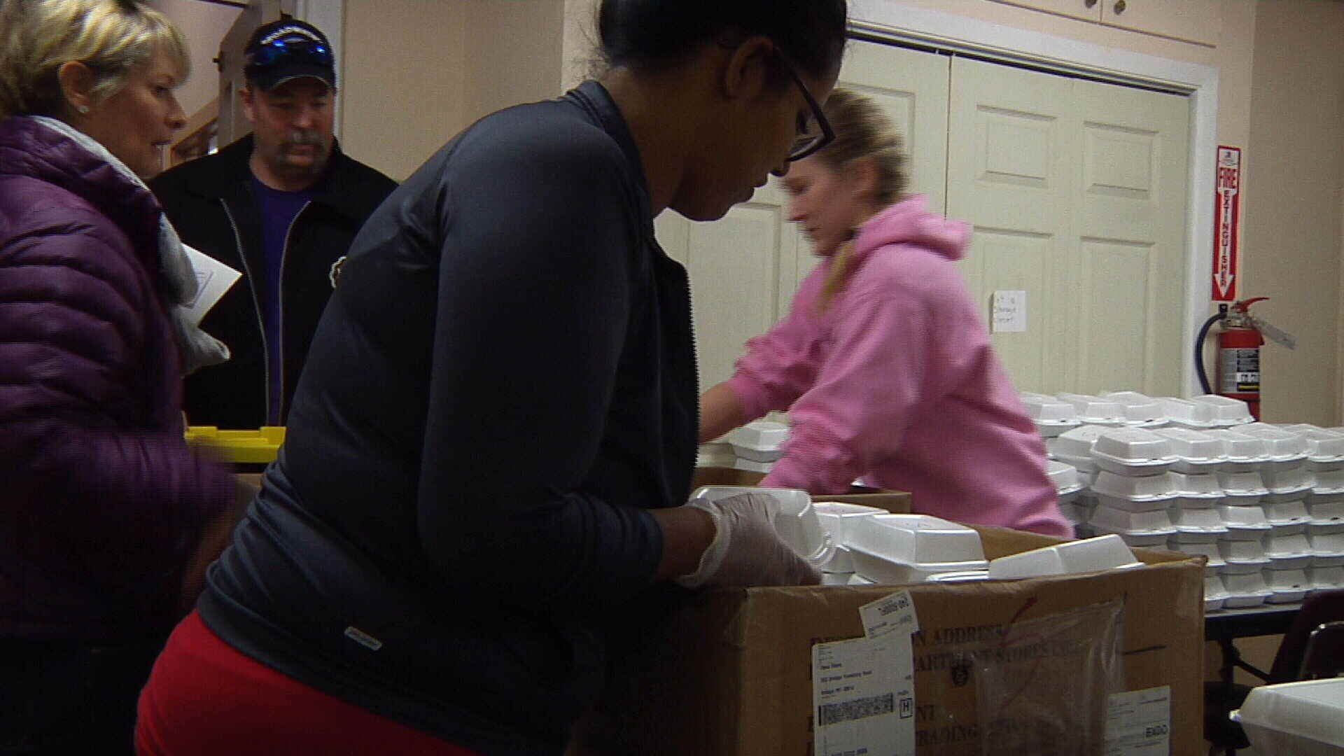 MRM Volunteers prepare Christmas meal delivery (MTN News photo)