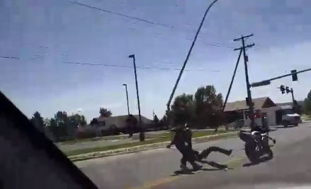 The video shows two men fighting in the street (Facebook)