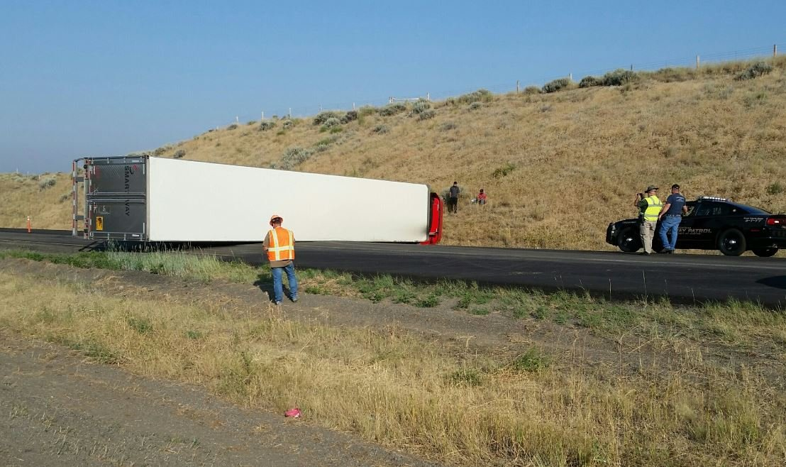 A semi rolled over and blocked both westbound lanes of I-94 east of Billings