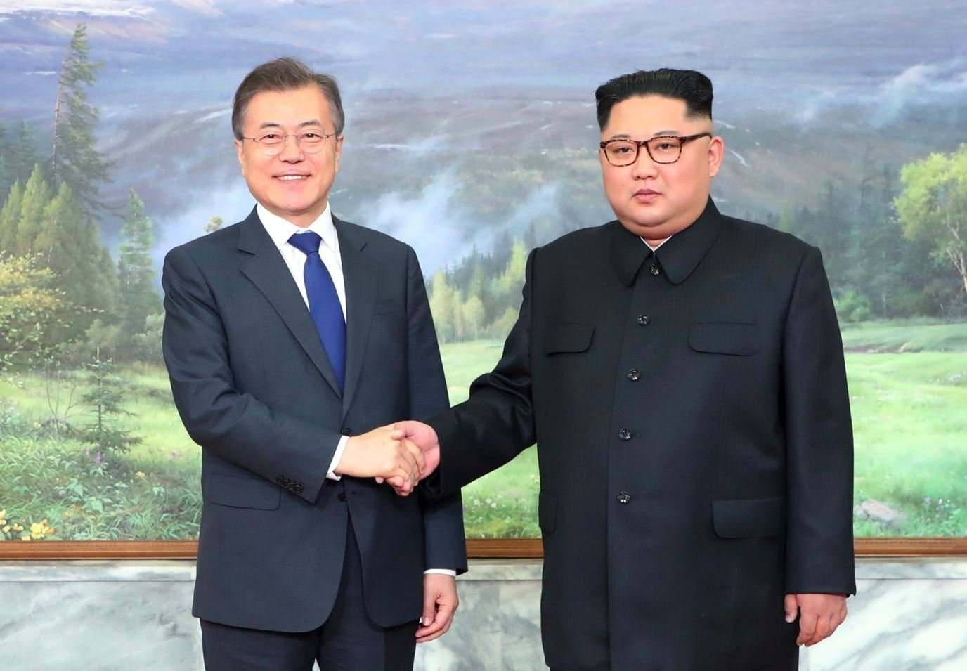 The North and South Korean leaders greet each other before Saturday's meeting. (CNN photo)