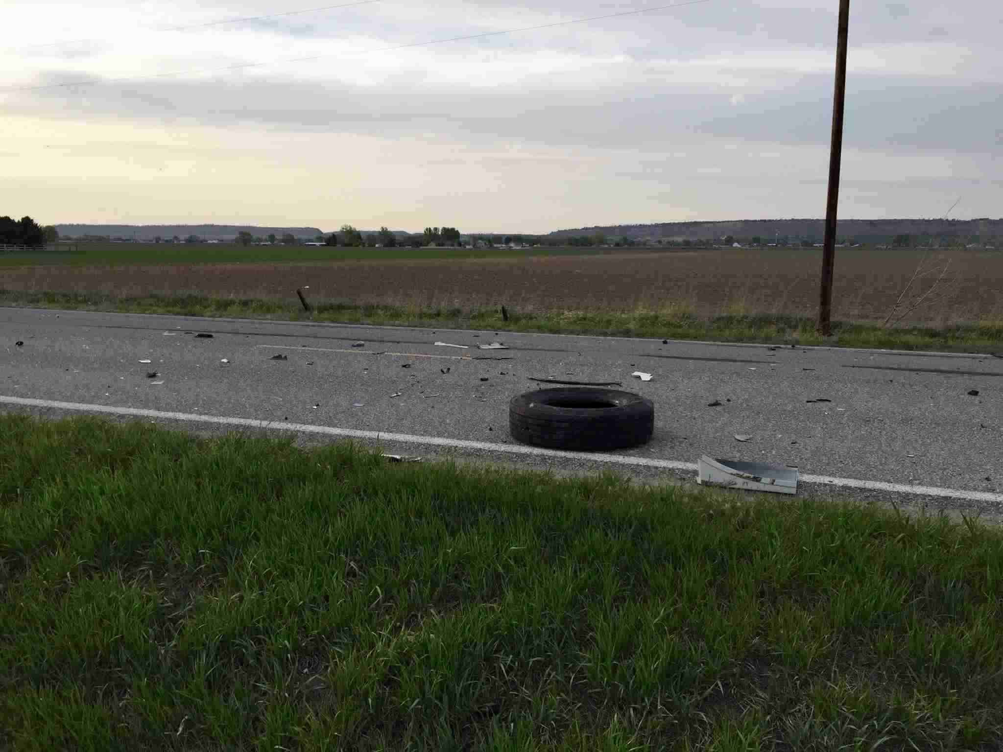 The crash dislodge the front tire of the semi-truck.
