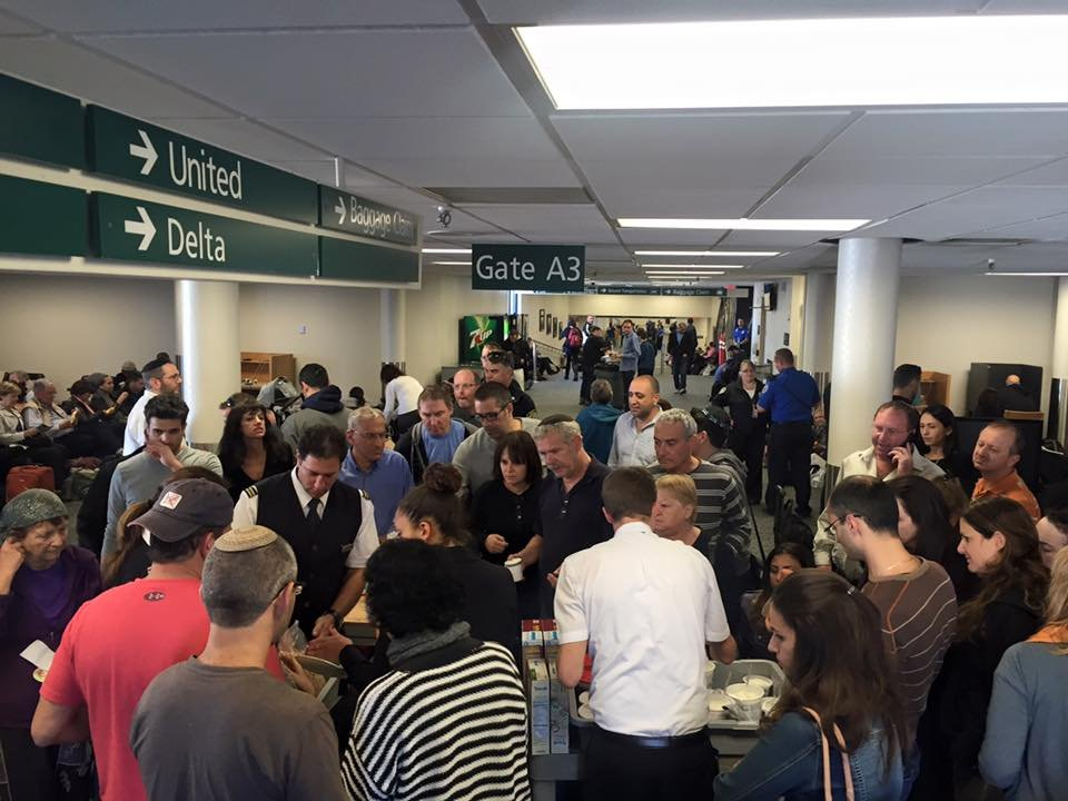 The wing at Billings Logan was packed with international passengers who found caring residents provide kosher food. (Photo courtesy: Kat Healy)